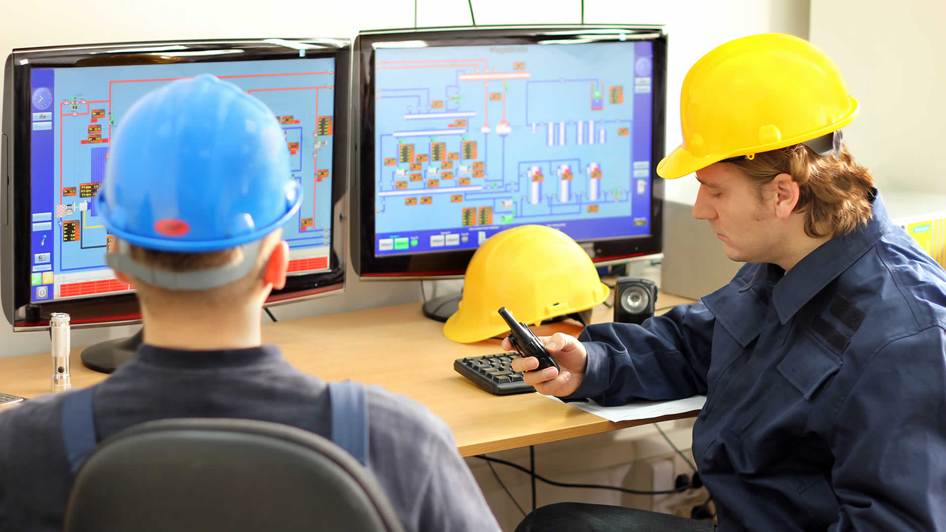 Operators in control room coomunicating manual valve positions