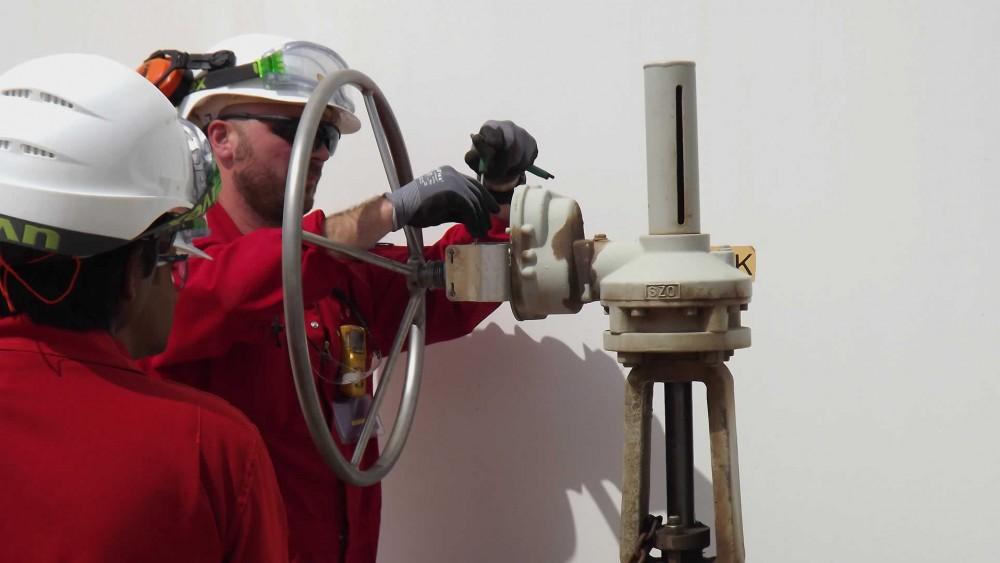 Valve interlock installed on a manual valve