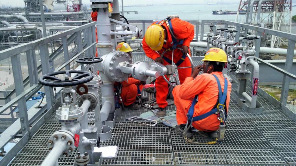 Service engineers installing valve interlocks