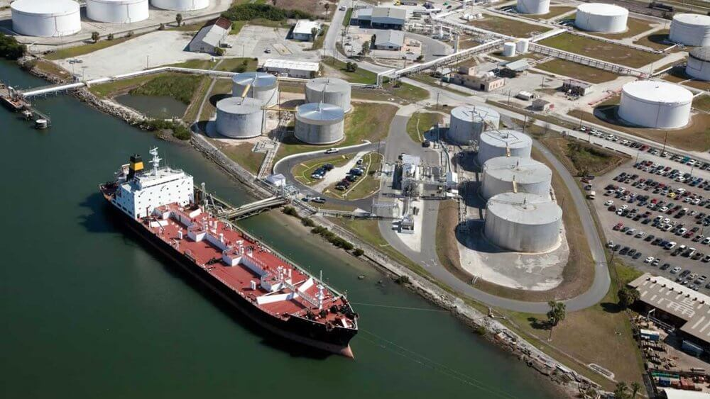 Tanker loading oil at a tank terminal