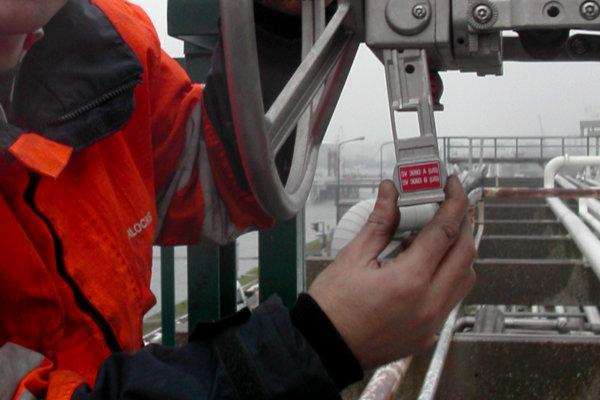 Operator inserts key in a valve interlock